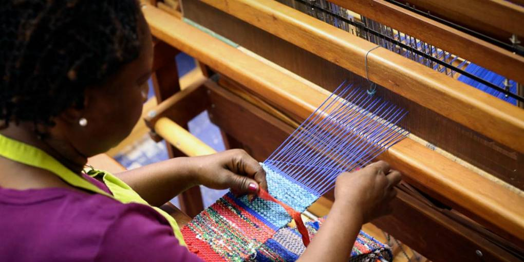 woman working loom